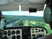 Final approach to runway 24 at Gaston's fishing resort 3M0 in Arkansas.  Great place to fly with cottages along the White River, restaurant that extends over the river with great views, swimming pool, and nature walks. Submitted by John Heilmann on 10/15/2009